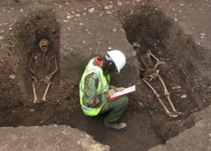 Medieval friars found in town dig to be reburied